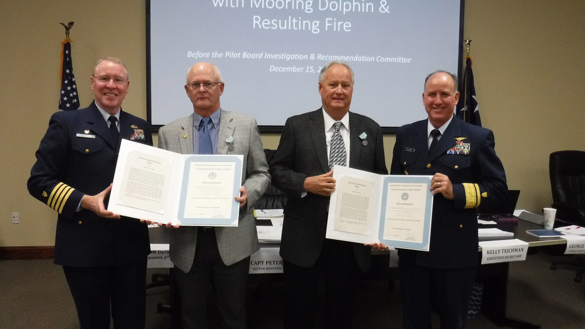 Capt. Peter Martin, commander, Sector Houston-Galveston, and Rear Adm. David Callahan, commander, 8th Coast Guard District, present the Coast Guard Meritorious Service Award to Houston Pilots Captains Michael McGee and Michael Phillips, Feb. 10, 2017. They received the award for their outstanding response to the Aframax River tanker fire in the Houston Ship Channel, Sept. 2016.