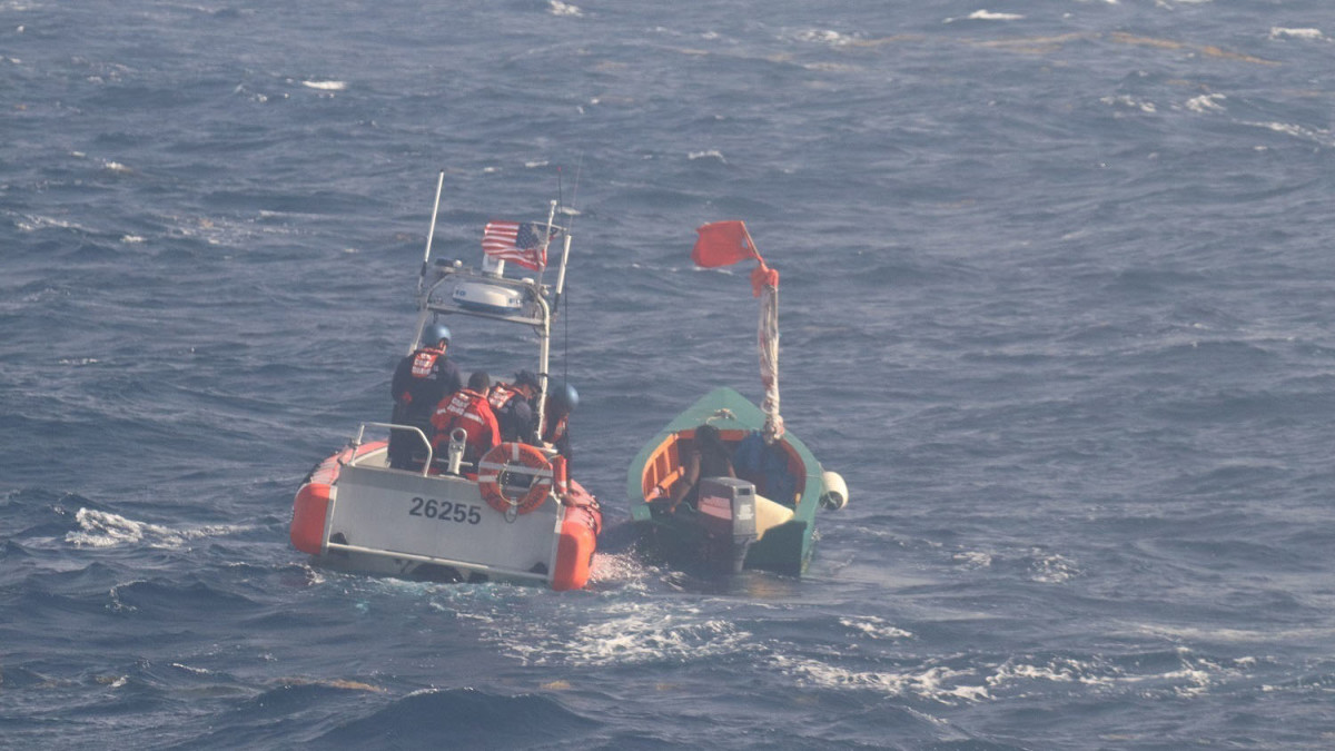 The boat crew of the U.S. Coast Guard Donald Horsley Over the Horizon Boat is on scene with a 20-foot boat disabled and adrift with three Dominicans from the island of Dominica June 8, 2018.