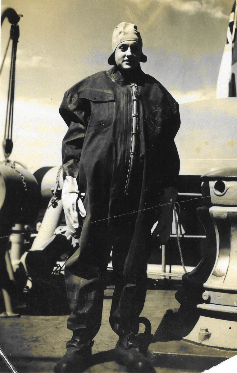 A state-of-the-art military issue survival suit issued onboard cutters on Arctic duty. Shown is a member of Coast Guard Cutter Haida wearing one of the survival suits.