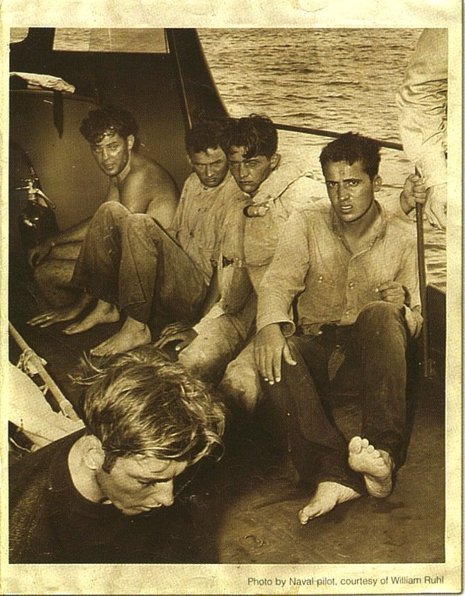 This photograph shows rescued survivors of Cutter Jackson's crew after floating for more than 50 hours off the coast of North Carolina. U.S. Navy photo courtesy of Bill Ruhl.