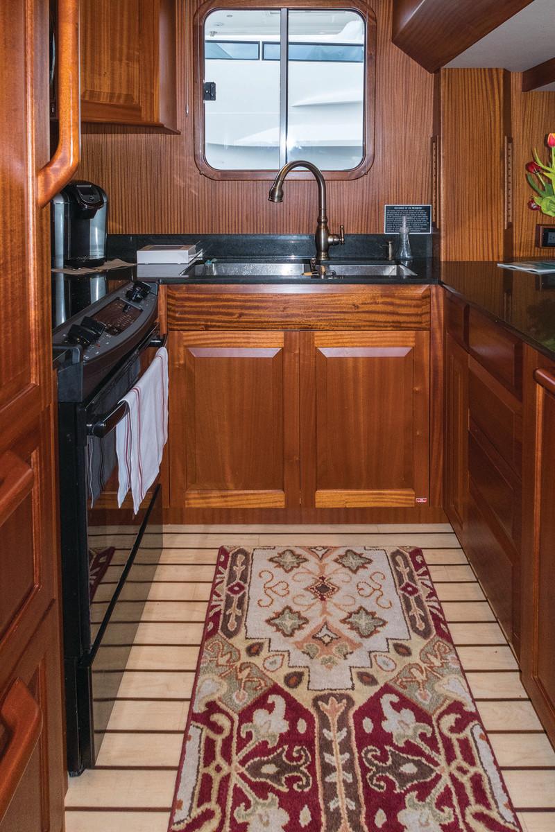 U-galley provides plenty of storage and full sized appliances.