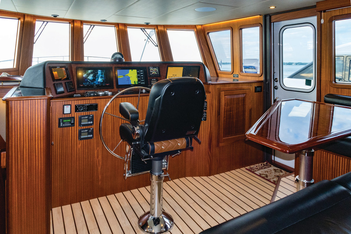 The raised pilothouse helm with additional seating.