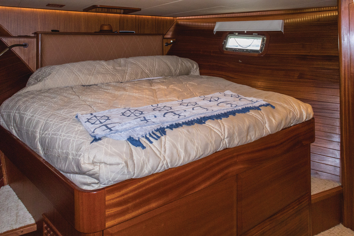 The immense forward berth includes walk-arounds and plenty of under-berth storage.