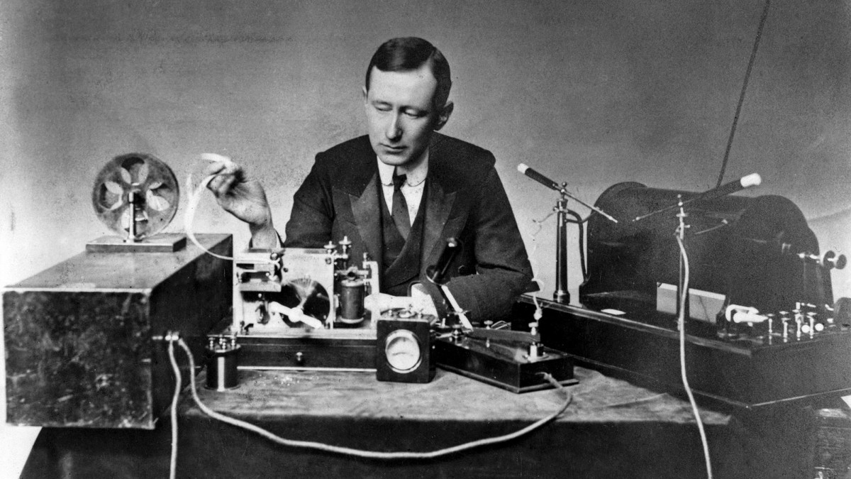 Electrical engineer/inventor Guglielmo Marconi with the spark-gap transmitter (right) and coherer receiver (left) he used in some of his first long-distance radiotelegraphy transmissions in the 1890s.
