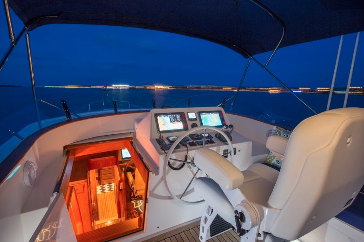 The bridge deck helm provides a commanding view of the world around the boat.