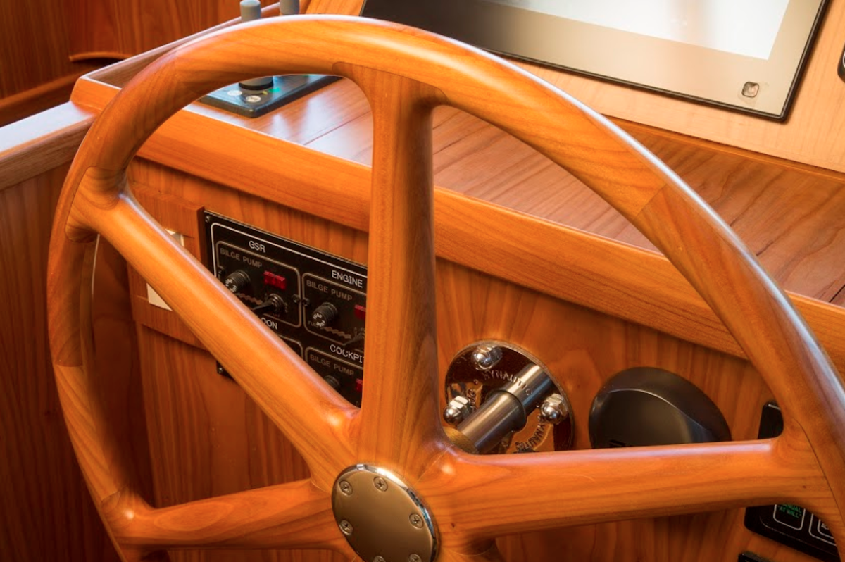 Artisanal touches, such as a solid cherry steering wheel, abound on the Krogen Express 52.
