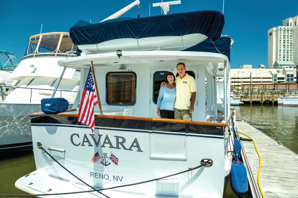 "Barb and Don Cavin stand on the aft deck of Cavara. The couple ""crossed their wake"" for the first time in 2018, the term for finishing the Great Loop."