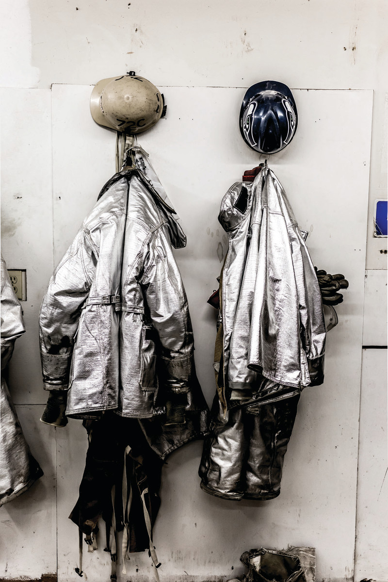 Space suits and hardhats protect against burns and injury at the foundry.
