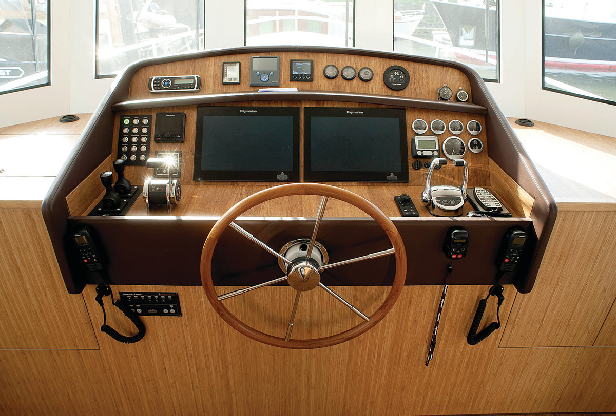 Centerline helm with a neatly laid-out dash featuring twin Raymarine MFDs.