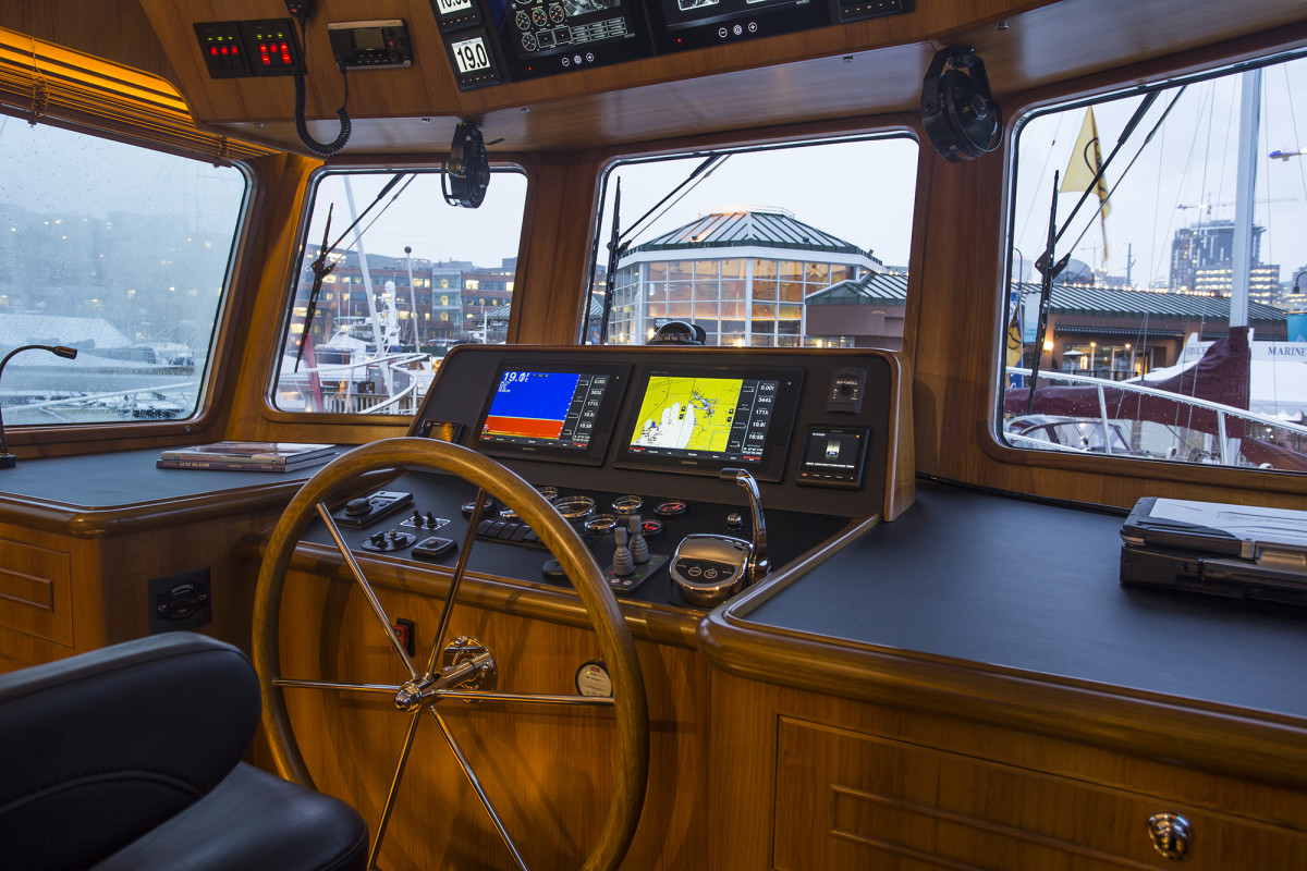 The pilothouse layout is clean and simple. Note the reverse rake windows.