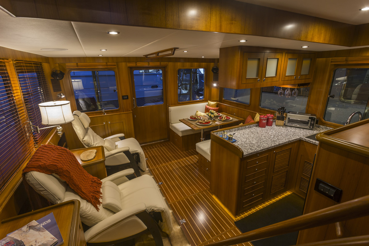 The saloon takes advantage of the full beam with a heavy door leading to the aft deck.