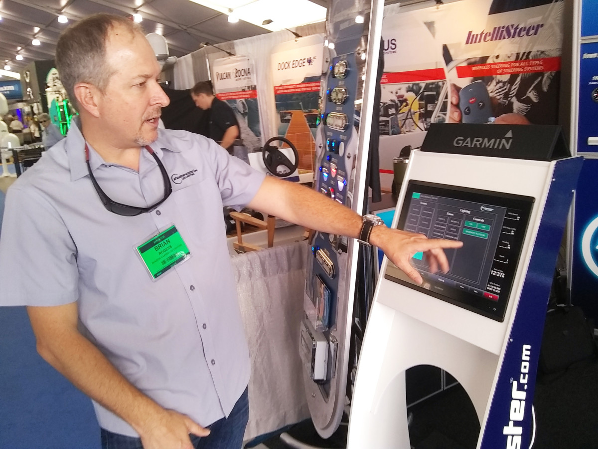 At the Miami International Boat Show, Shadow-Caster president Brian Rogers demonstrates how a lighting control system might work.