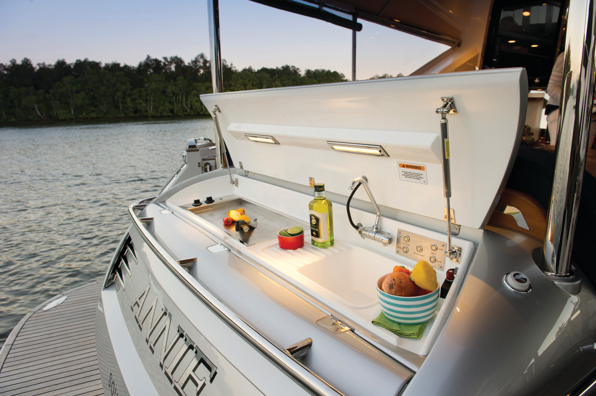 The transom hides a cleverly-designed griddle/grill and wetbar.