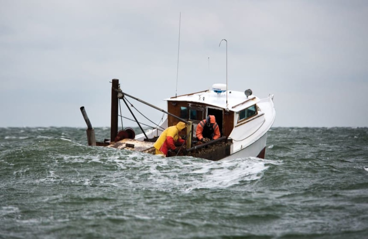 Crab fishermen battle building seas.