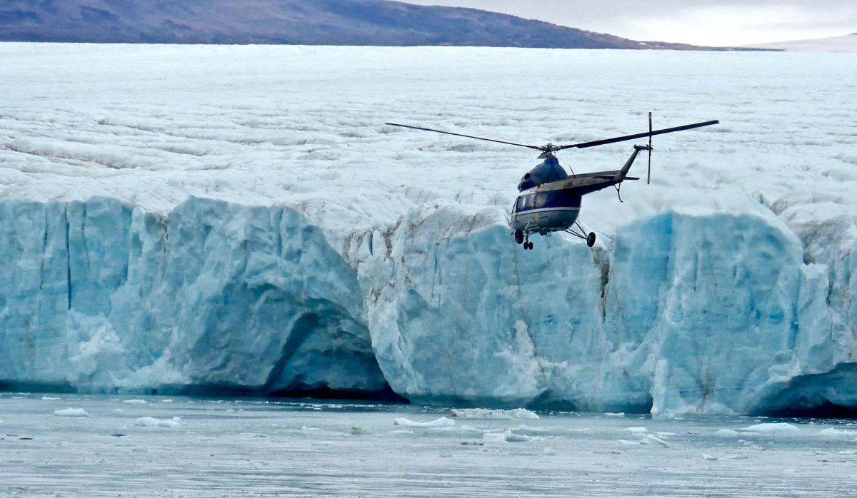 Kapitan Khlebnikov's twin-engine Russian helicopter flies a few kids and residents from Grise Fiord to the ship for a prepared show.