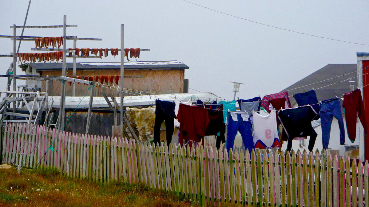 Clothes and fish are hung out to dry in Qaanaaq, formerly named Thule.