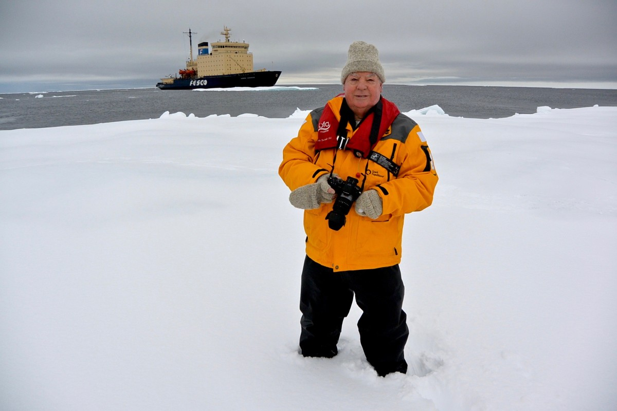 Tony Fleming on an iceflow with the Kapitan Khlebnikov in the background.
