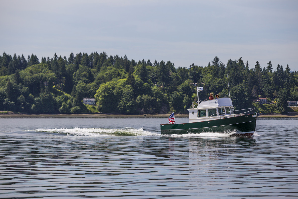 The designer/builder's newest creation, the Kingfisher 33, during sea trials on south Puget Sound.