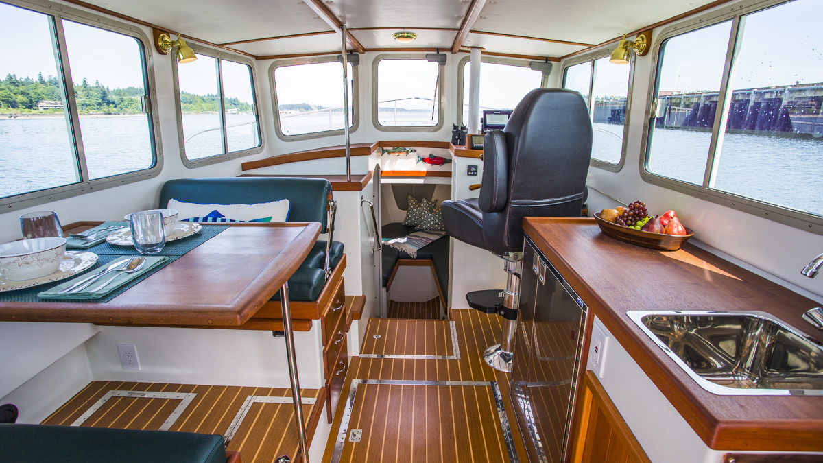 The saloon and helm on Kingfisher is designed for simplicity, with a straight galley and versatile dinette seating. Due to the size and number of windows and the painted white ceilings, the saloon and forward accommodations are bathed in natural light, essential for boating in Pacific Northwest waters.