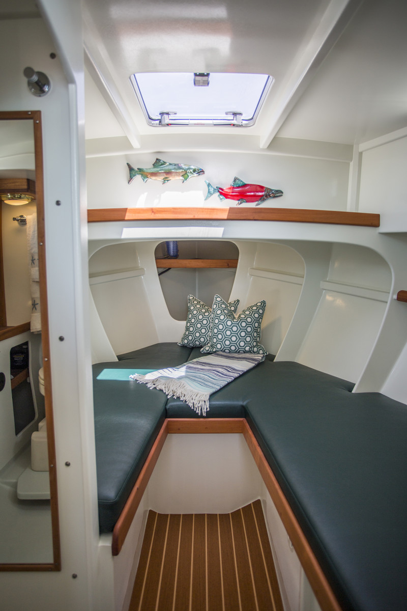 The forward cabin is painted brilliant white, making it light and airy.