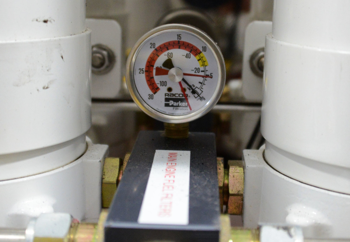Restrictions in the fuel supply often show up on the vacuum gauge at the primary fuel filter. Reset the tracer needle (red) after each run. The needle will remain at the high reading for each day's run and can point to a clogged filter or some other restriction in the fuel lines.