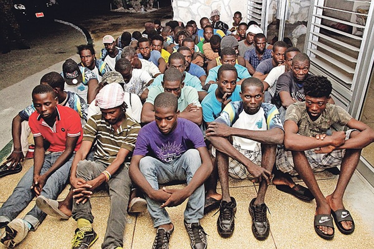 Captured migrants await repatriation.