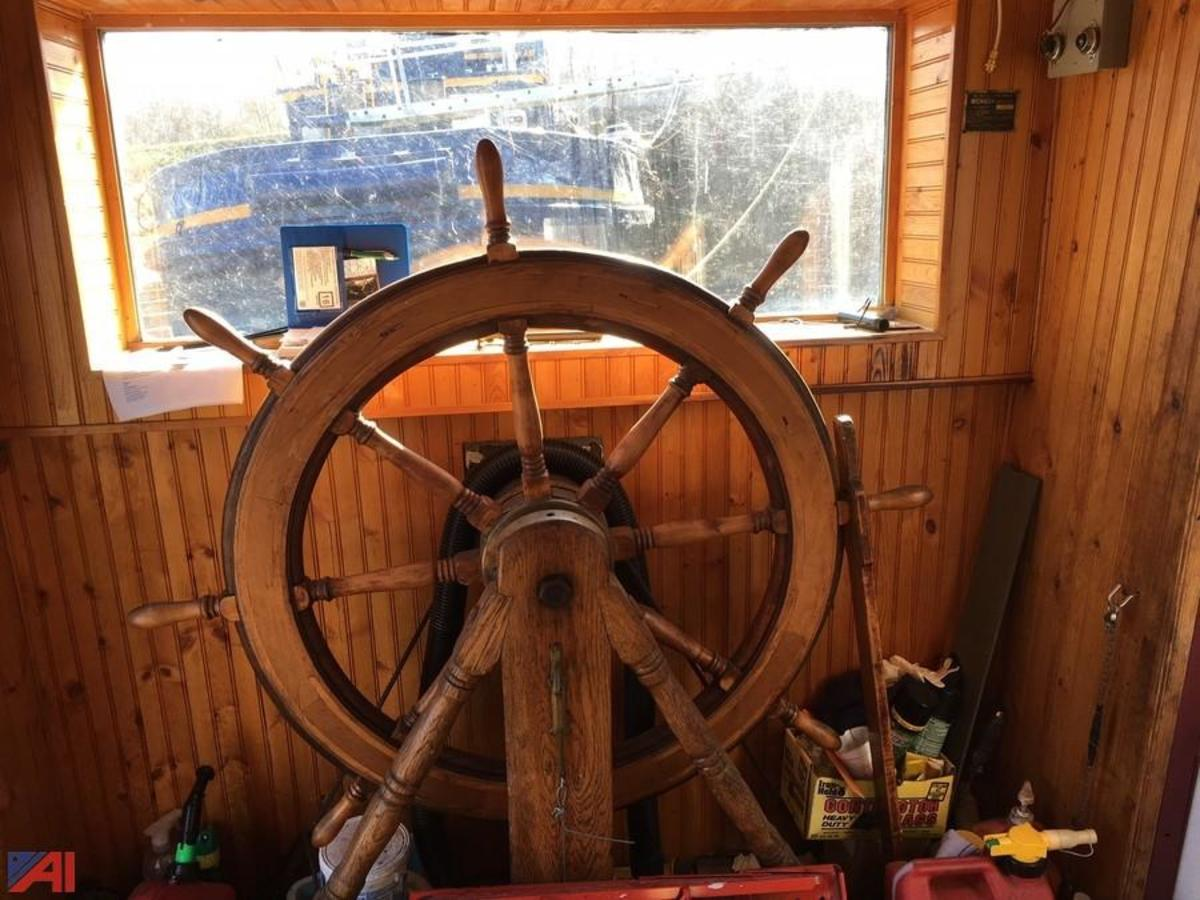 That's why they call it a wheelhouse! With a make 'n' break engine, there is no transmission, therefore no shift lever. Reversing and throttle control is accomplished with commands to crew in the engine room.