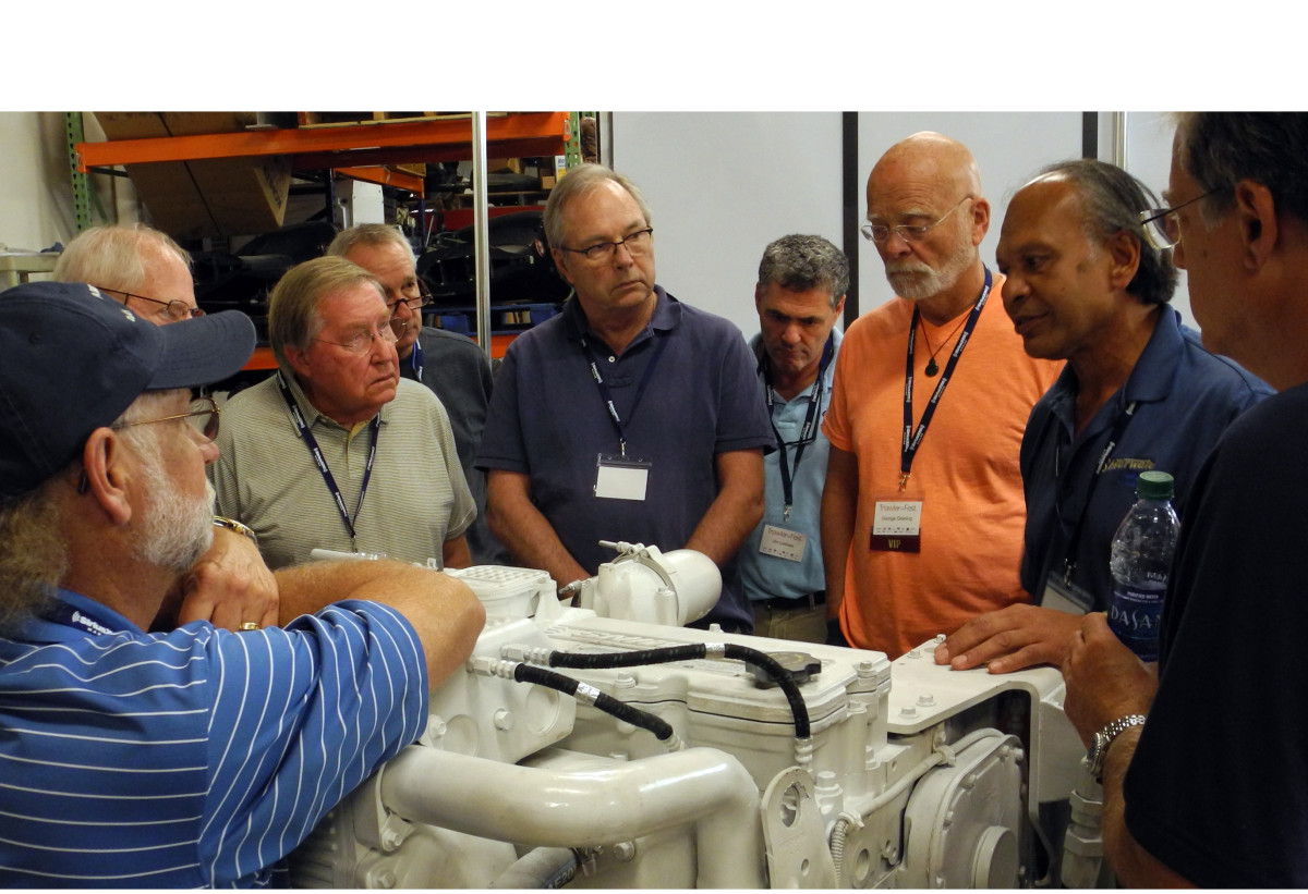Diesel instructor Adolf Ellert enlightens attendees on the working of a Cummins engine.