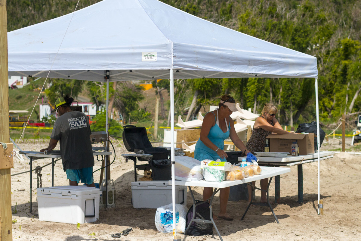 Marcie and a few friends prep the barbecue with hotdogs, burgers, and fresh wahoo.