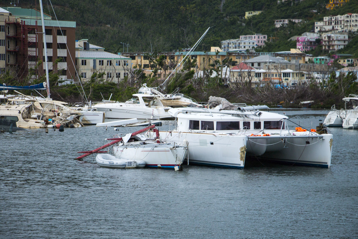 Boats damaged by Hurricane Irma sit anchored or beached in Road Town's Inner Harbour on Tortola.