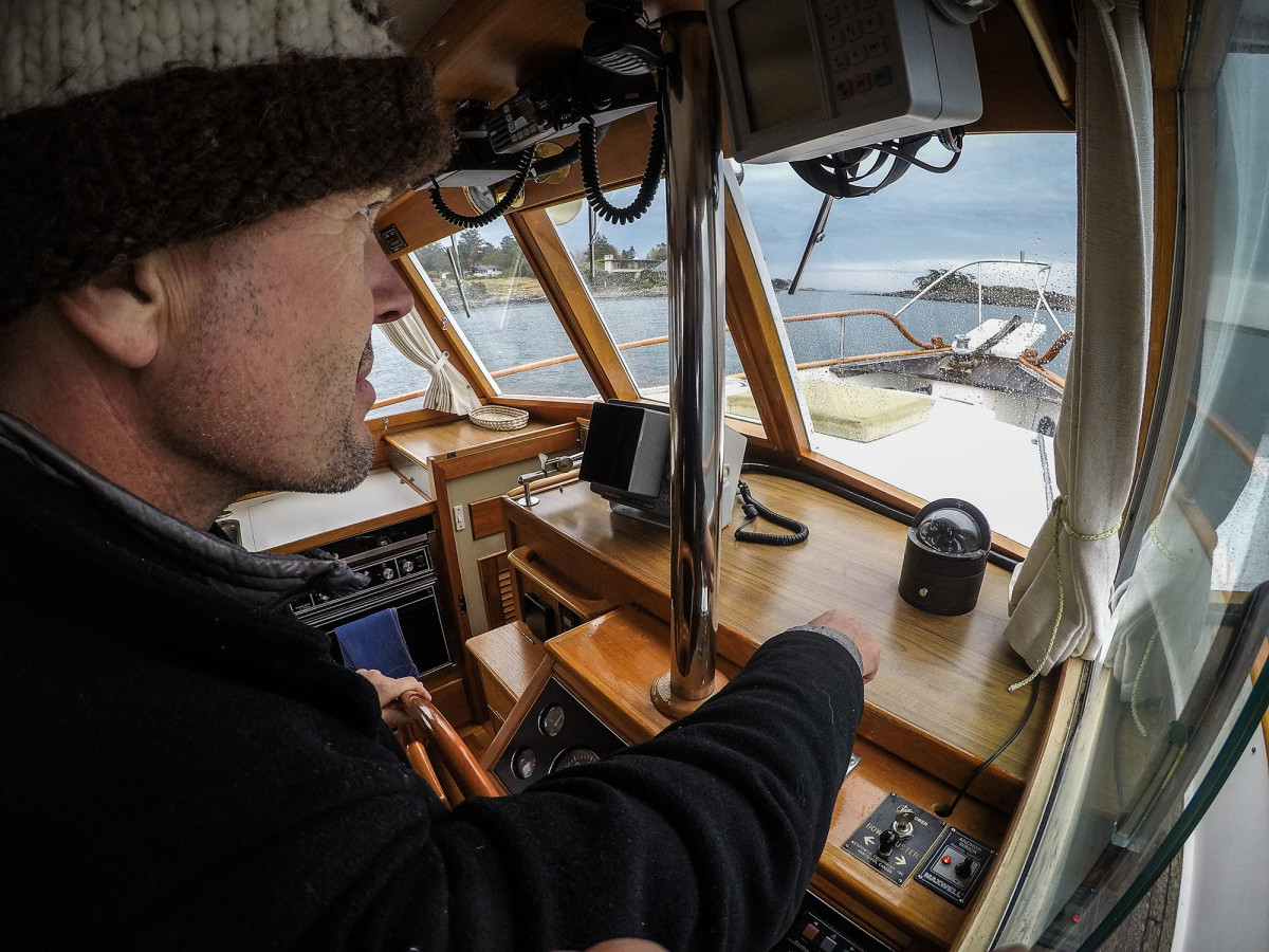 As the person on the wheel will not be able see where the rode is, a person on the bow is required to ensure the anchor comes up properly without damaging the vessel.