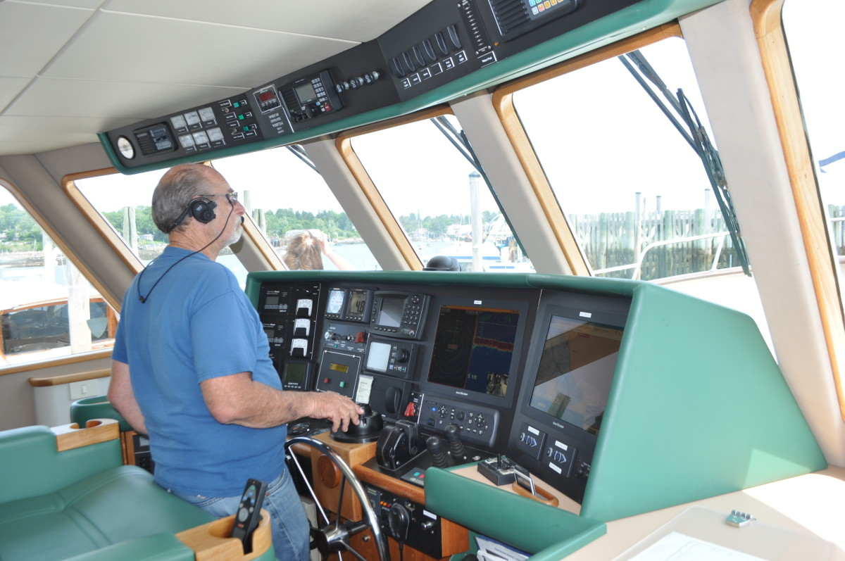 Bruce Kessler at the helm of Spirit of Zopilote, the first recreational powerboat to circumnavigate.