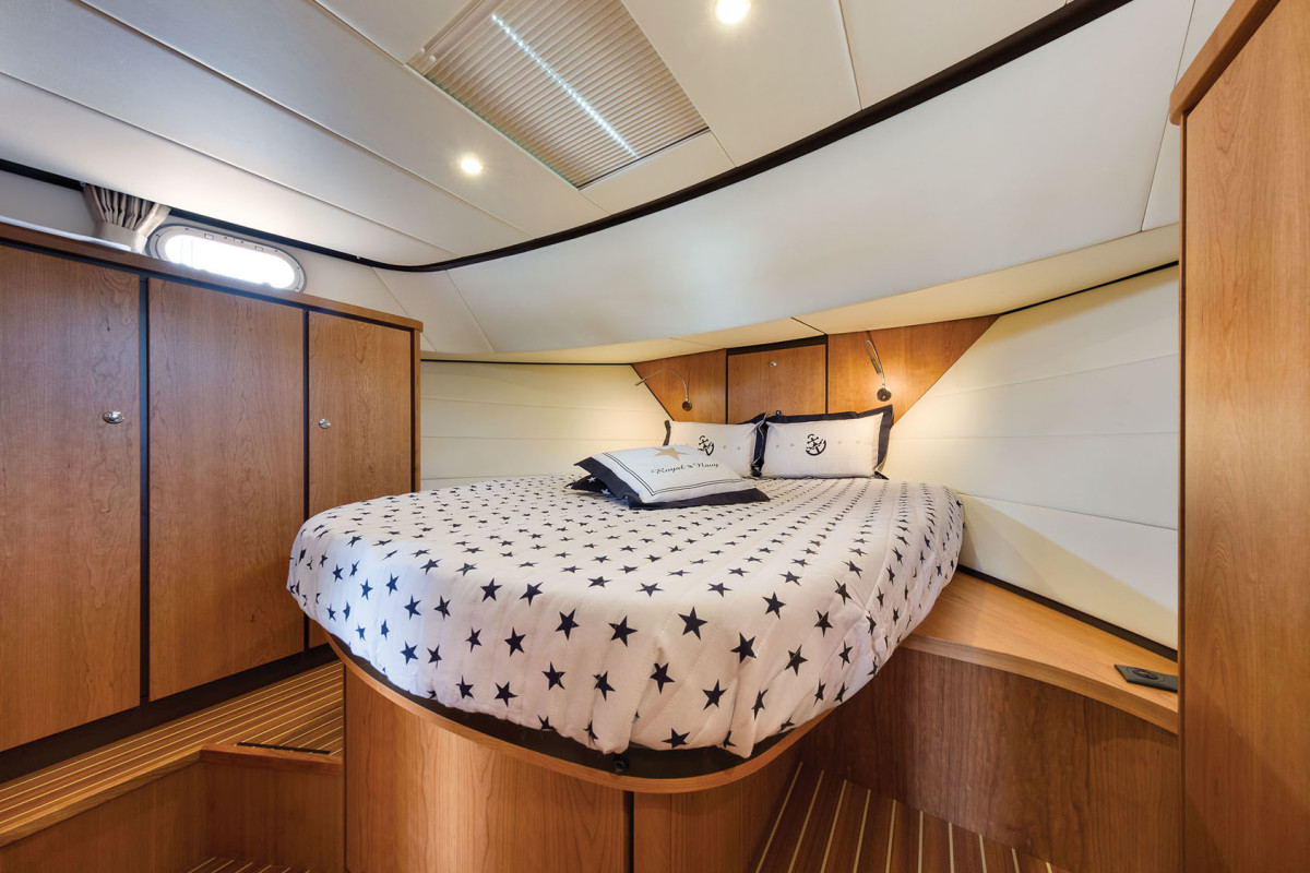 The master stateroom is light and bright, with ample headroom for tall owners and guests.