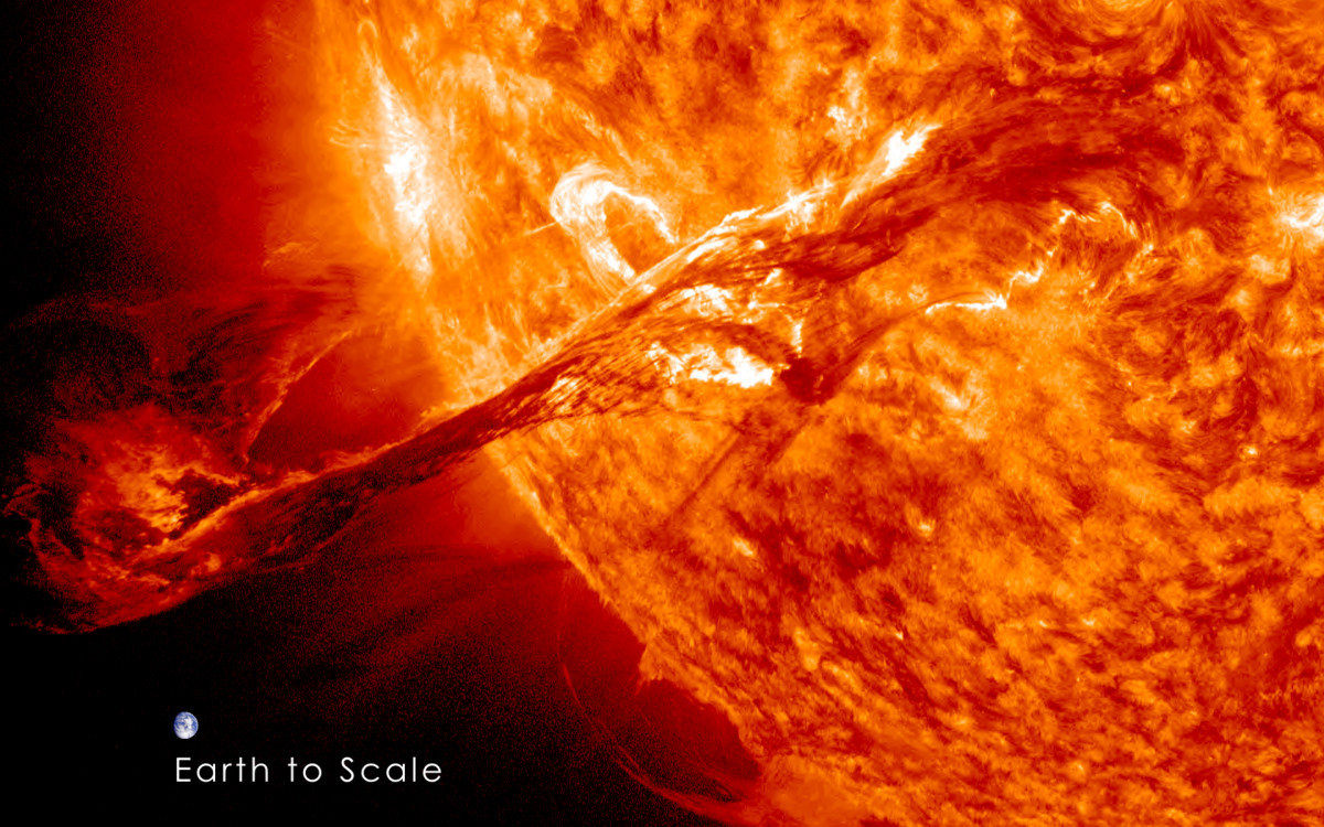 The image compares the size of Earth to that of a Solar coronal mass ejection.