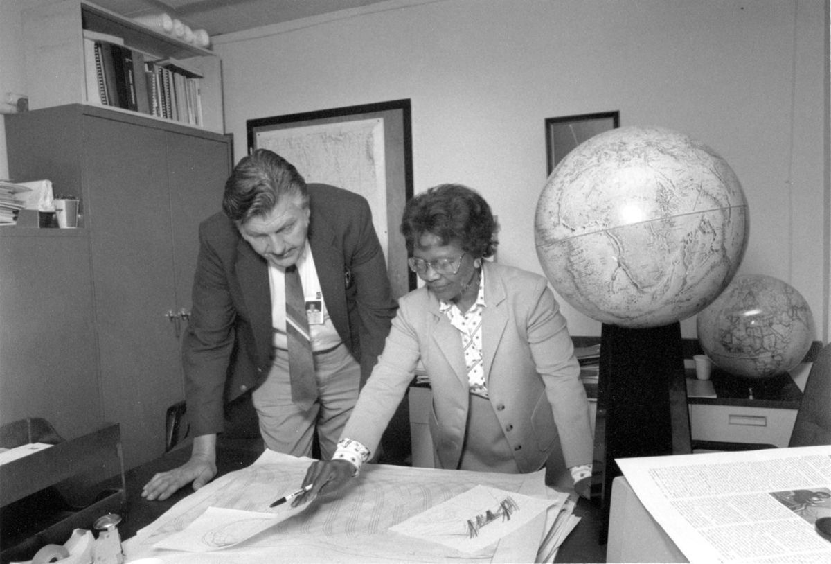 Sam Smith reviews data with Gladys West in 1985 at the Dalhgren Division.