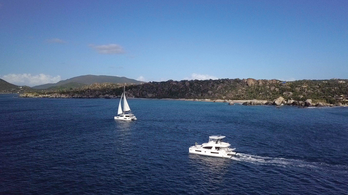 Our Moorings powercat and sailing catamaran departing The Baths on Virgin Gorda.