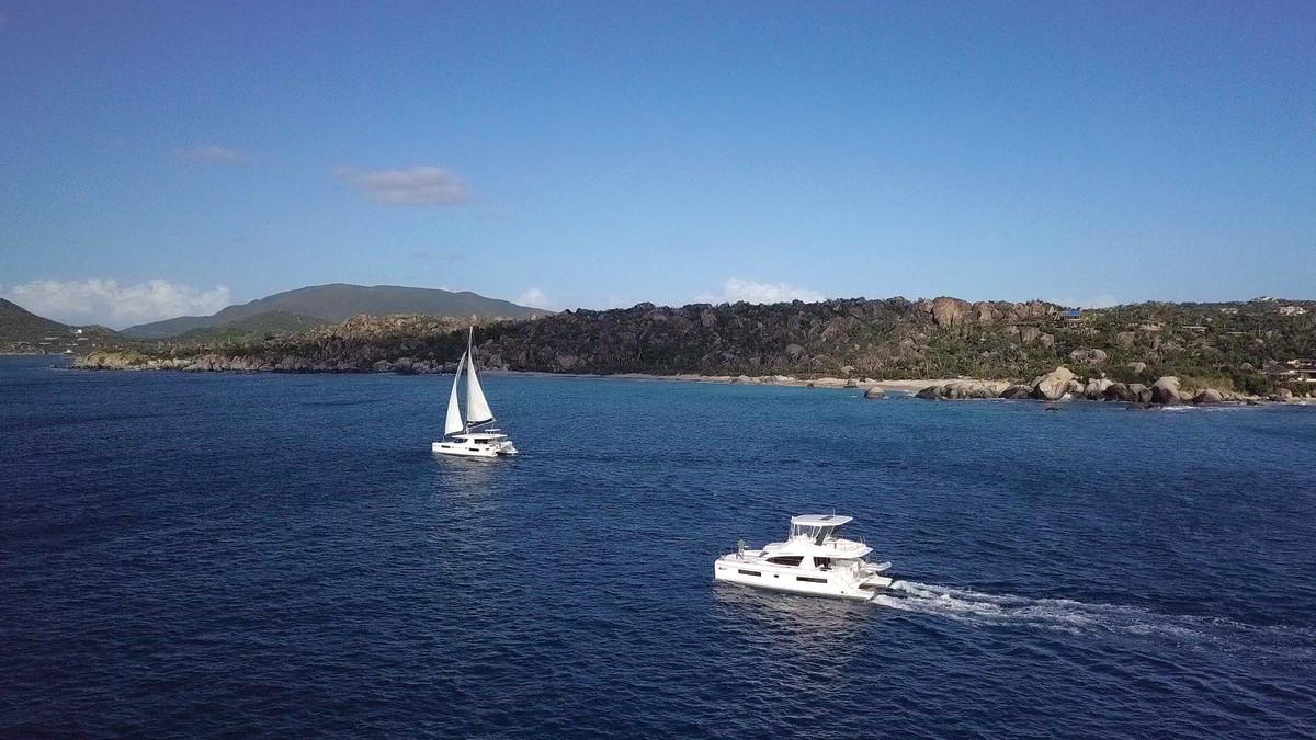 Our Moorings powercat and sailing catamaran departing The Baths on Virgin Gorda.