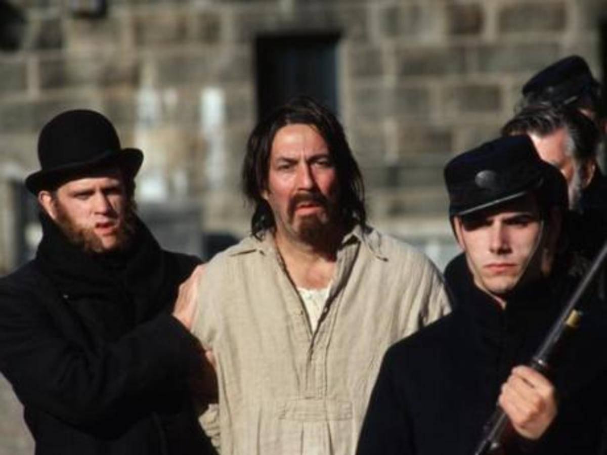 "Axe murderer Louis Wagner under arrest in the movie ""Weight of Water."""