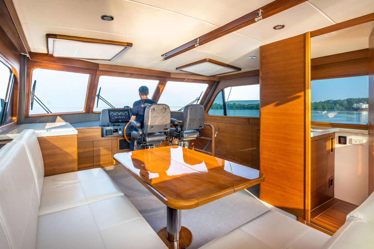 The key to a great long-distance cruiser is having plenty of distinct social spaces for family and guests to spread out. The enclosed bridge adds yet another comfortable living space for enjoying the ride.