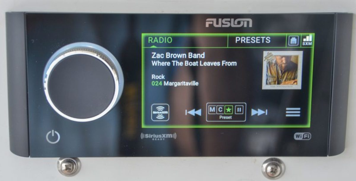 The cockpit Fusion MS-RA770 head unit running in PartyBus mode (as indicated by the green border) from flybridge stereo