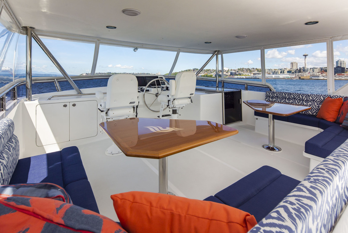 With comfortable seating, the beamy flybridge is another ideal entertaining space. And you can't beat the view.