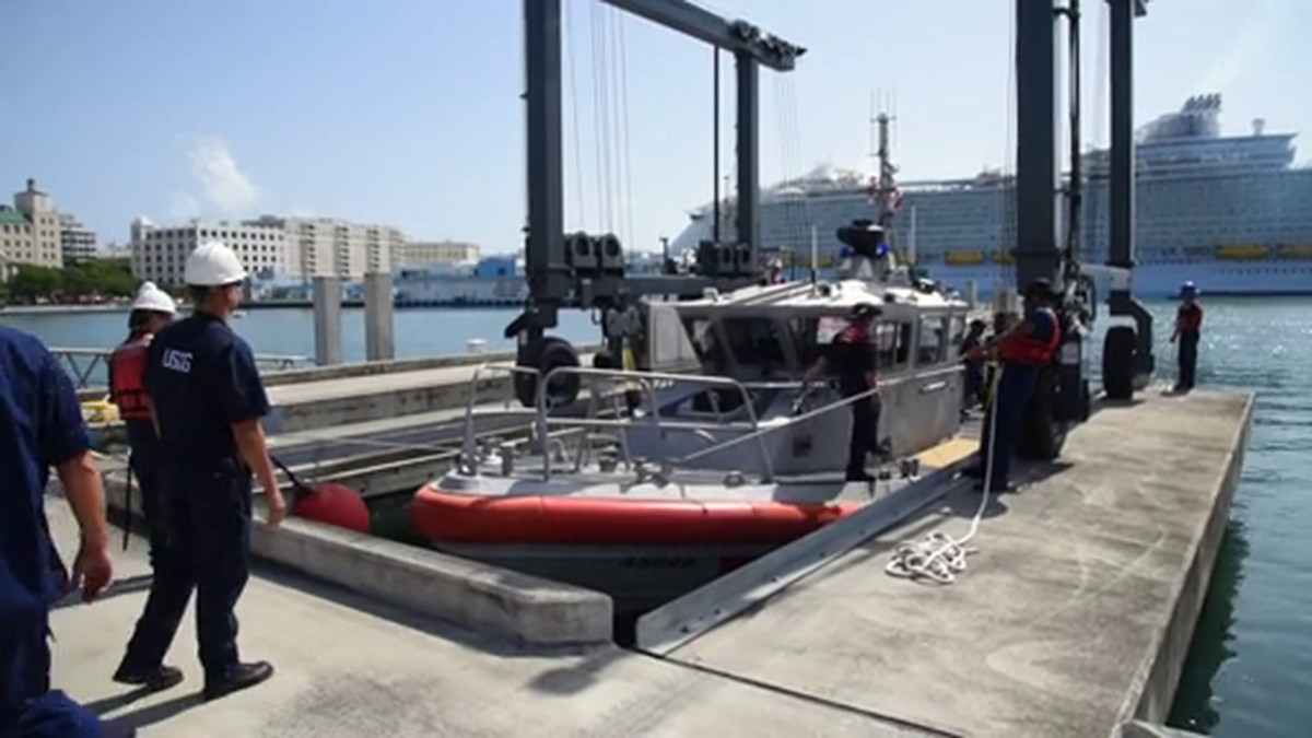 Boat Station San Juan personnel pull their Coast Guard 45-foot Response Boat Medium out of the water as part of storm avoidance preparations at Coast Guard Base San Juan Aug. 27 2019 in anticipation to Tropical Storm Dorian's approach to Puerto Rico.