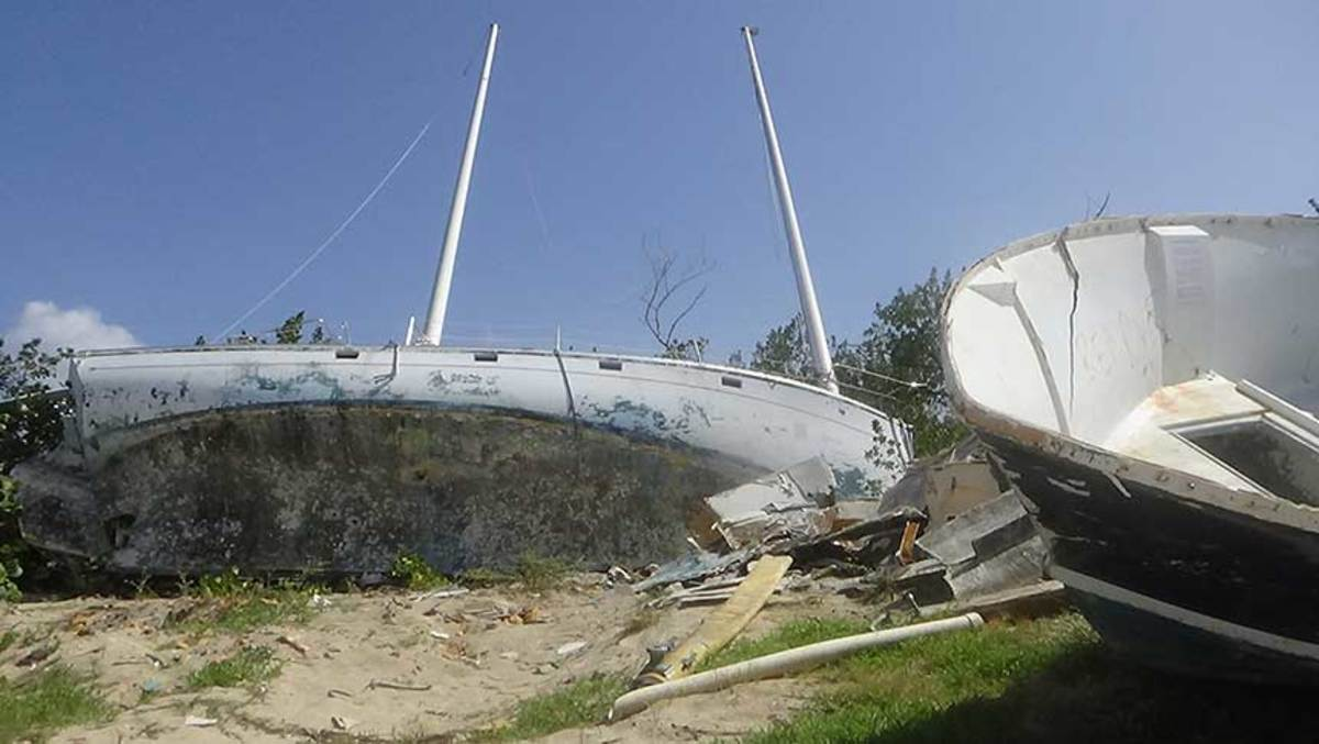 Dozens of wrecked boats were still waiting for disposal, including these on Beef Island at Trellis Bay.
