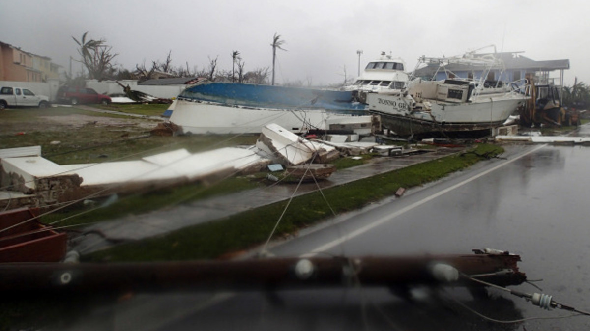 Boats across the street from the harbor, all destroyed