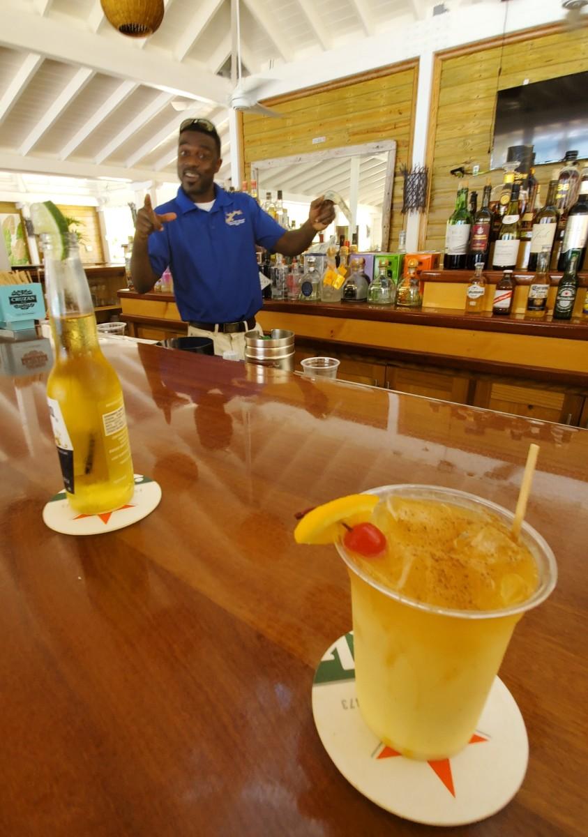 "A British Virgin Islands bartender serves a rum punch cocktail called ""Painkiller."""
