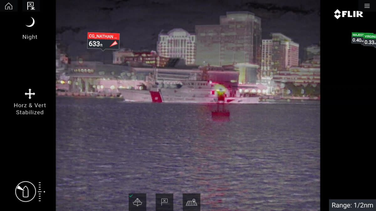 An Axiom with a FLIR M364C showing the glow from the red LED on the buoy.