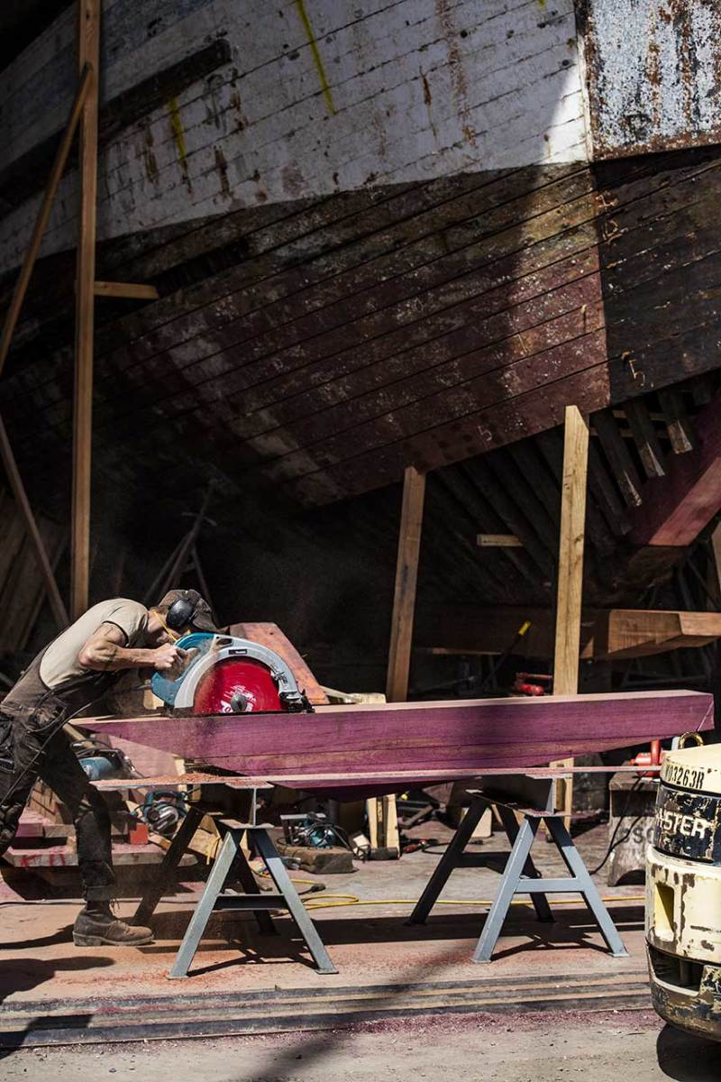 Stein wrangles a piece made from purpleheart, a durable and decay resistant wood.
