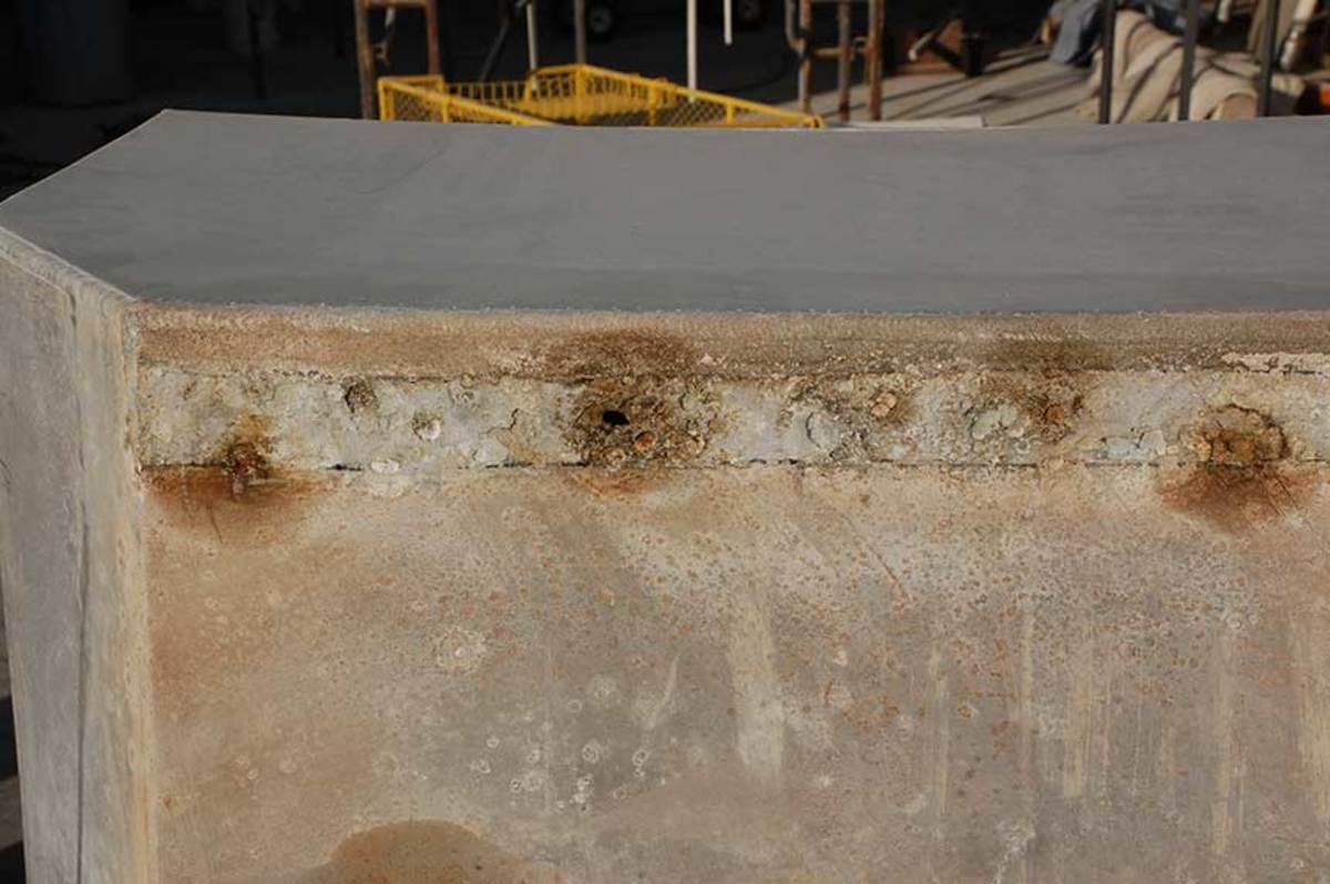 The aluminum tank above rested on moisture-absorbing material. As a result, poultice corrosion attacked the contact areas, leading to tank failure.