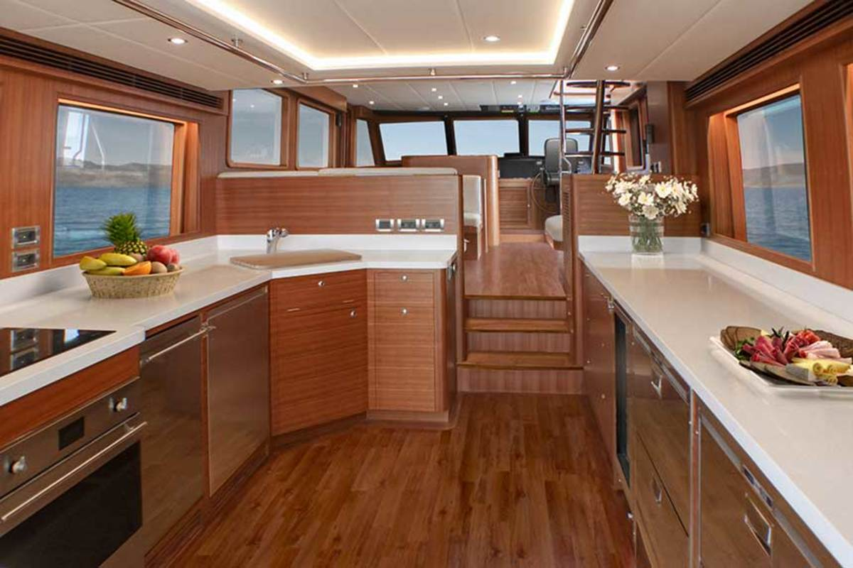 The main deck is equipped with an aft galley in the deckhouse, designed to merge with the aft deck for alfresco dining and socializing.