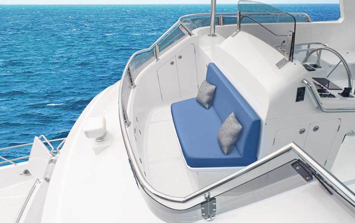Forward of the flybridge helm, the new Bridgeview Deck has protected seating for two and a 180-degree panoramic view.